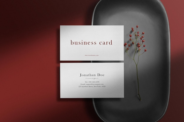 Clean minimal business card mockup on white stone floor and light shadow.