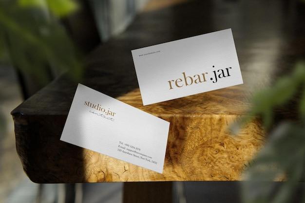 Clean minimal business card mockup on wood bar