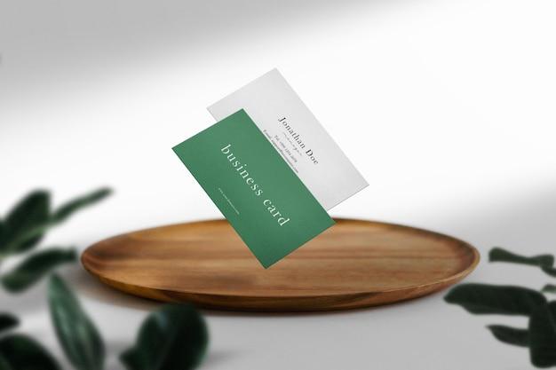 Clean minimal business card mockup on wood plate
