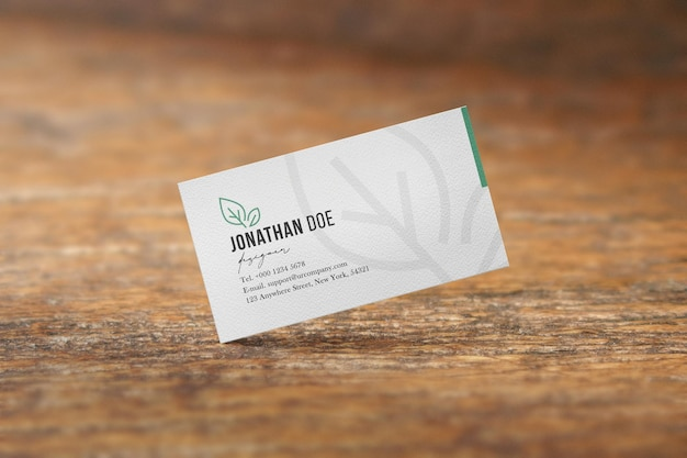 Clean minimal business card mockup on wood table background. psd file.