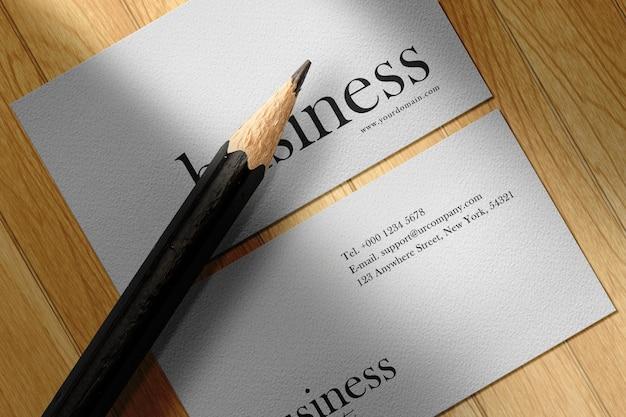 Clean minimal business card mockup on wood table
