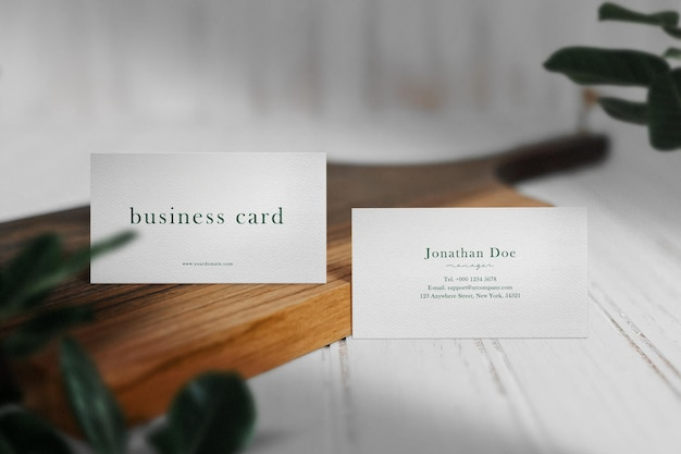 Clean minimal business card mockup on wooden plate