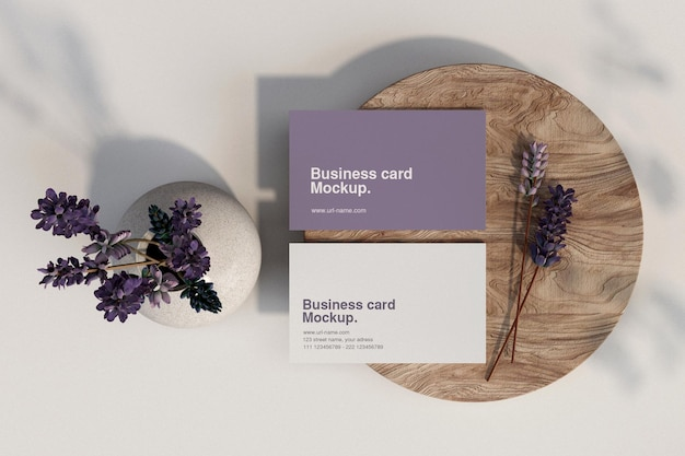 Clean minimal business card with floral mockup on wood small plate