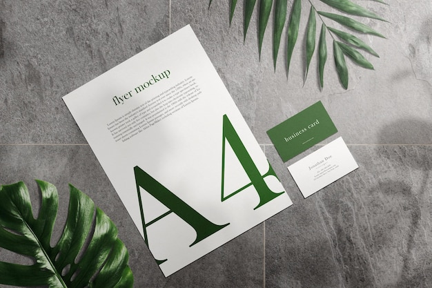 Clean minimal business cards mockup and a4 flyer on stone texture with leaves