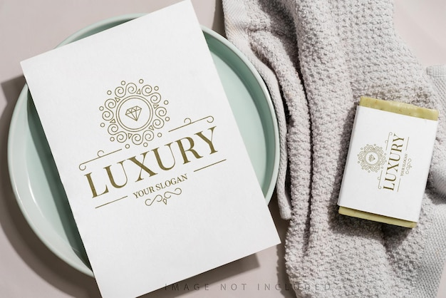 Clean and soft towel with paper mockup and olive soap mockup on grey