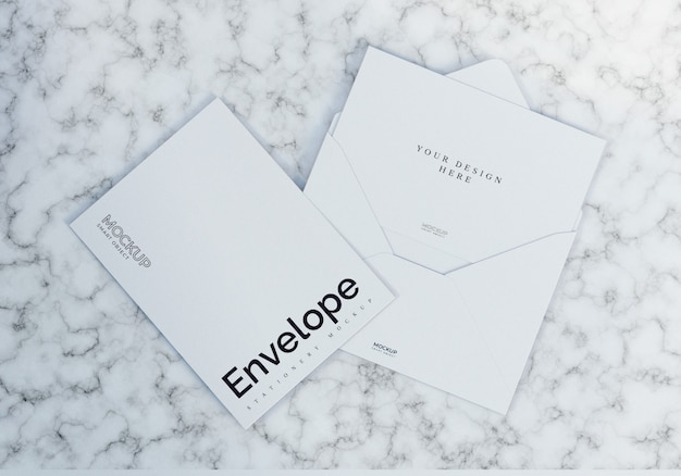Clean white envelope mockup with marble texture background