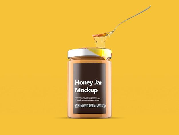 Clear glass honey jar with metal spoon mockup