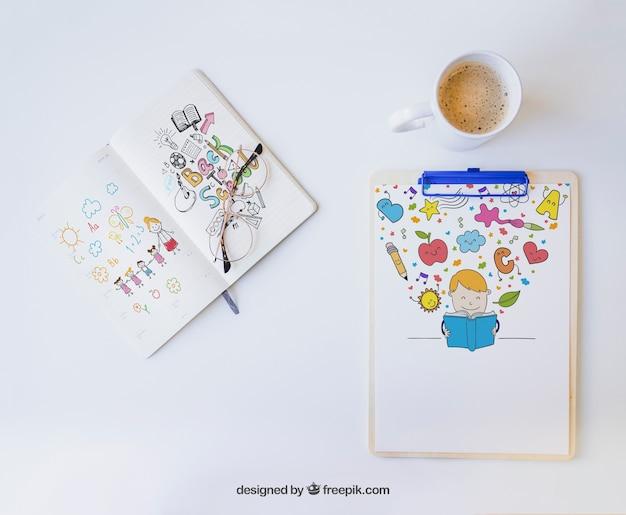 Буфер обмена и блокнот с цветными рисунками