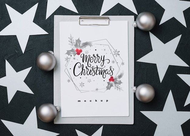 Clipboard mockup with christmas decoration
