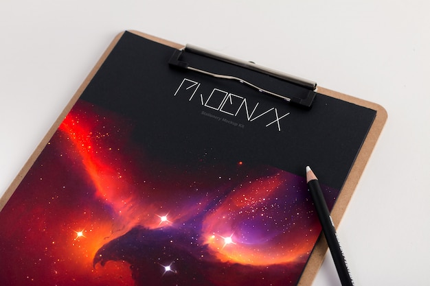 Clipboard mockup with a pencil