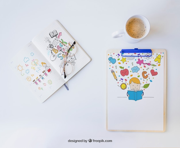 Clipboard and notebook with colorful drawings