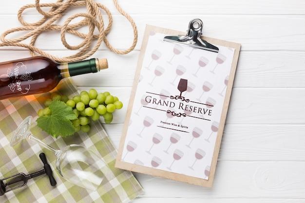 Clipboard with bottle of wine beside
