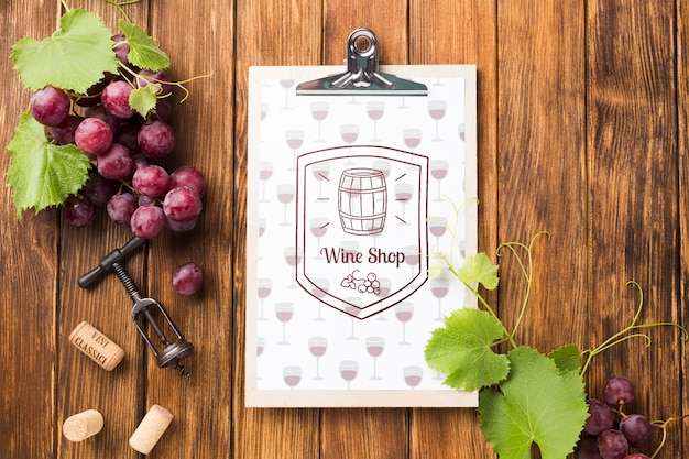 Clipboard with organic grape on table