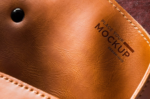 Close-up of brown leather with button