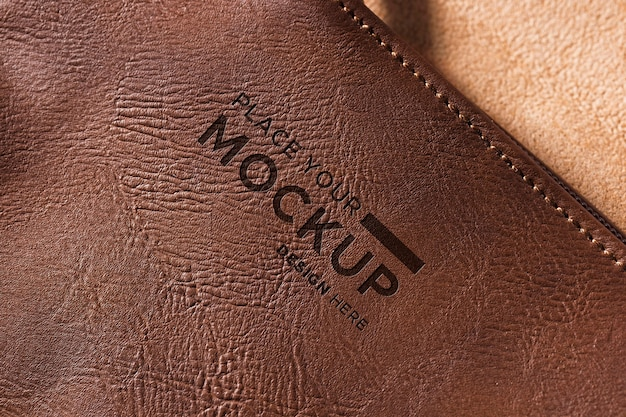 Close-up of brown leather with stitches