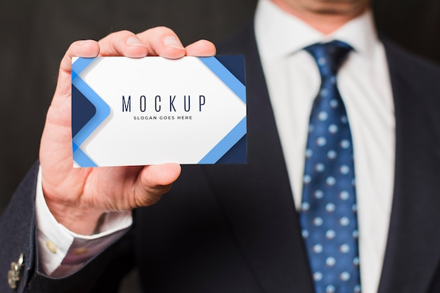 Close-up businessman holding business card