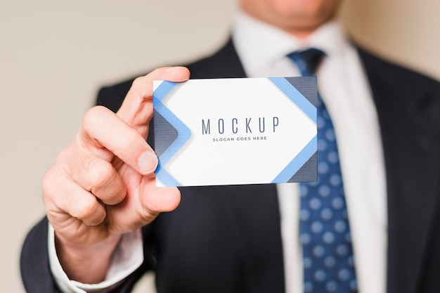 Close-up businessman holding card