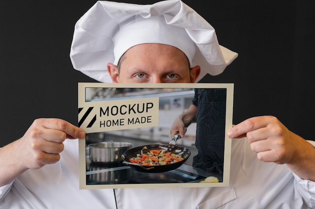 Close-up chef holding flyer
