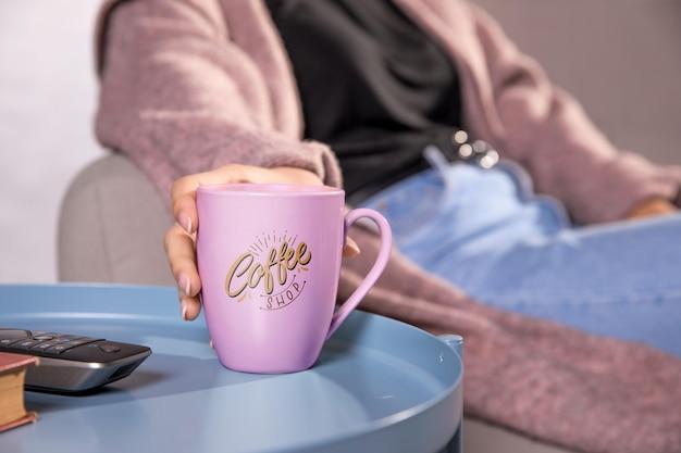 Close-up female with pink mug