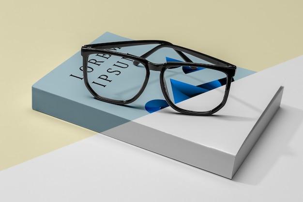 Close-up glasses on book mock-up