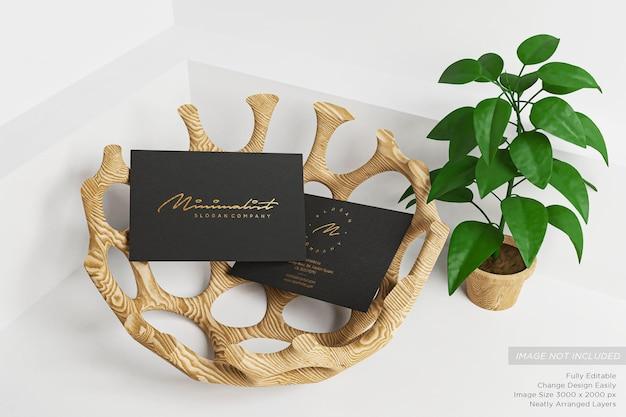 Close up on golden business card on black paper