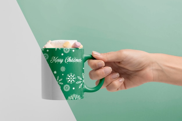 Close-up hand holding mug