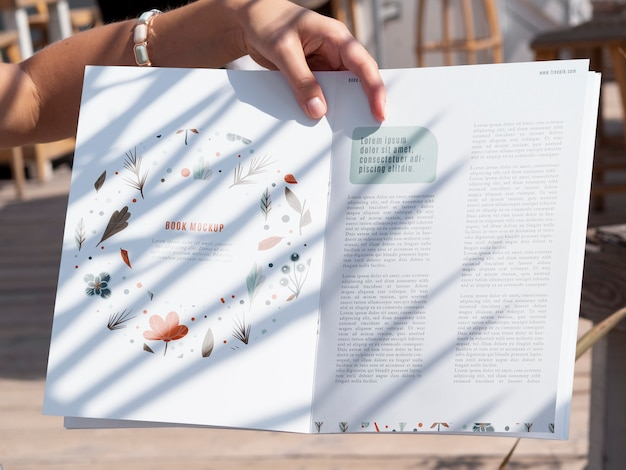 Close-up hand holding a nature magazine mock up