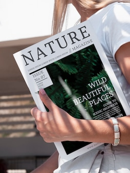 Close-up hand holding a nature magazine mock up