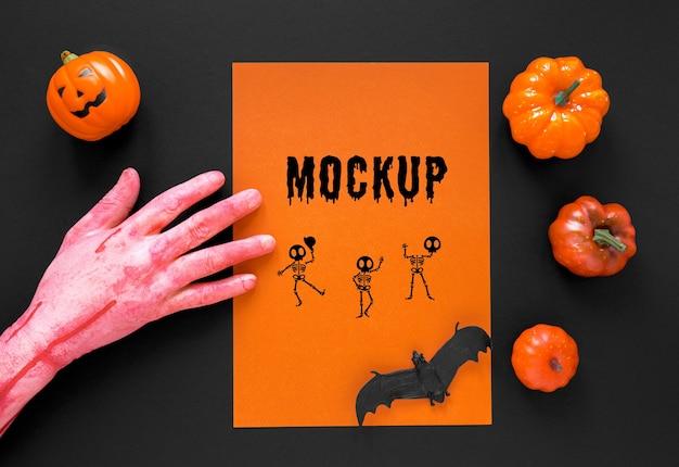 Close-up hand with pumpkins arrangement