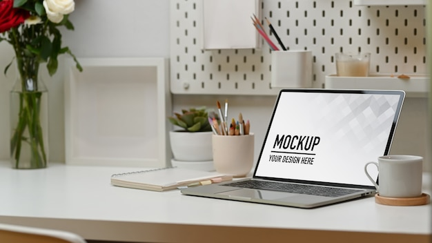 Close up on home office desk with laptop mockup