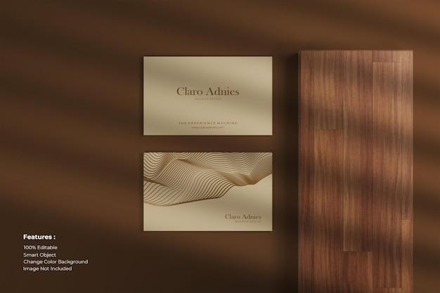 Close up horizontal business card mockup on wood