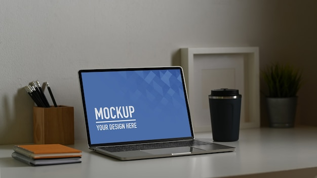 Close up of laptop mockup with coffee cup