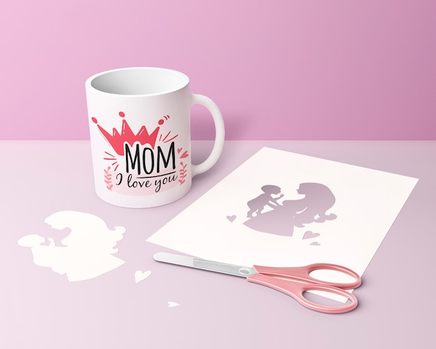 Close-up mother's day card and mug with scissors