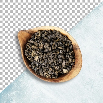 Крупный план сухого зеленого чая улун на деревянной миске с прозрачностью
