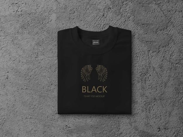黒の折りたたまれたtシャツのモックアップのクローズアップ
