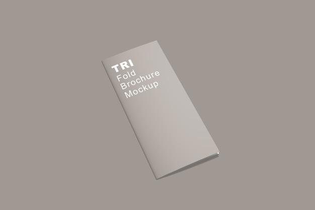 Крупным планом на брошюре trifold мокап изолированные