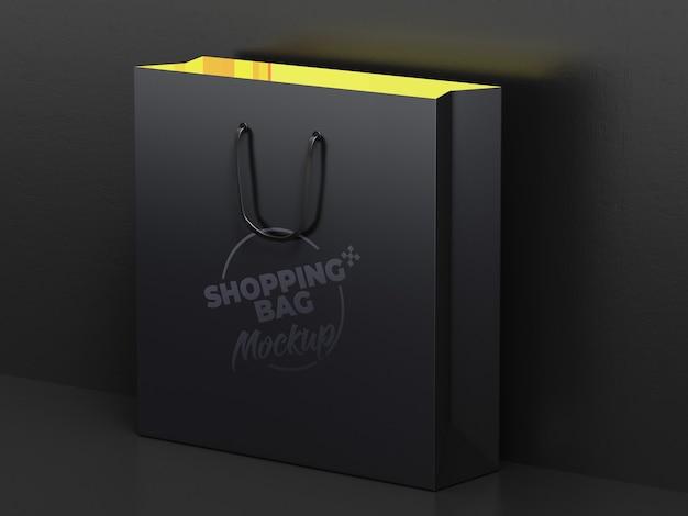 暗いショッピングバッグのモックアップデザインをクローズアップ