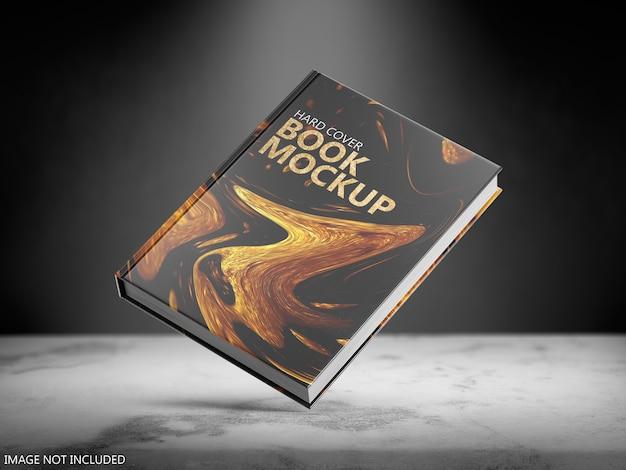 浮かぶハードカバーの本のモックアップにクローズアップ