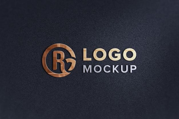 黒い壁のロゴのモックアップにクローズアップ