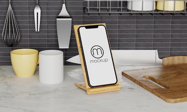 キッチンで電話のモックアップデザインをクローズアップ