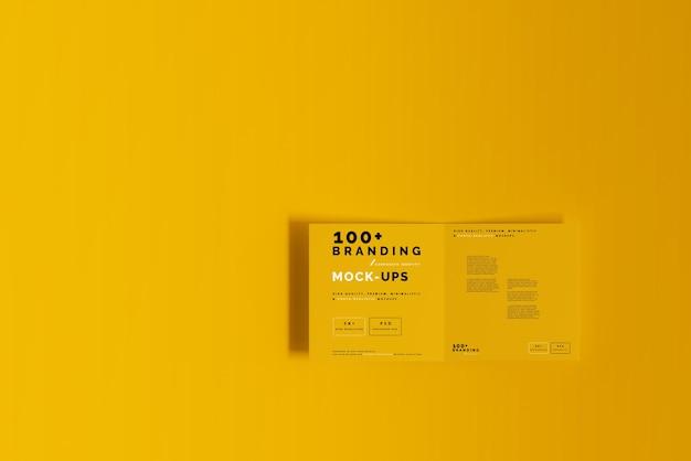 Close up on packaging of bi fold square brochure mockup