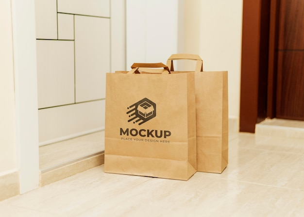 Close up on paper bags mockup delivered by courier