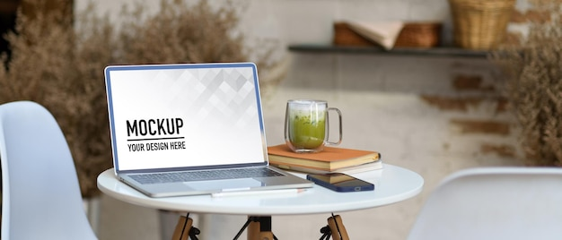 Close up of portable workspace with laptop mockup