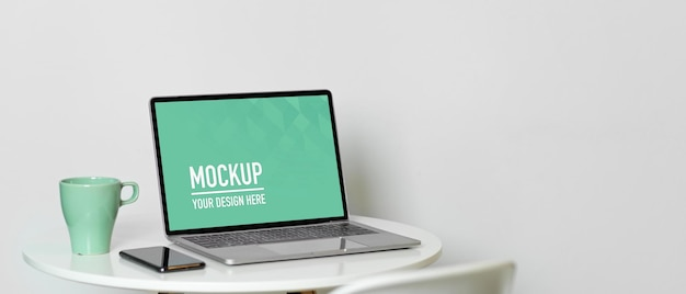 Close up on portable workspace with laptop mockup