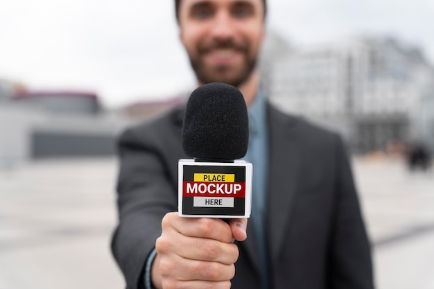 Close up on reporter holding microphone mockup