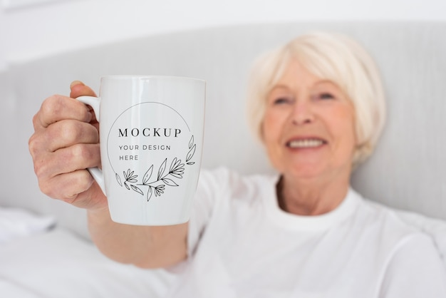 Close-up smiley woman holding mug
