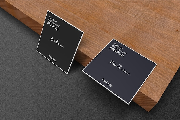 Close up square business card mockup on wood plank