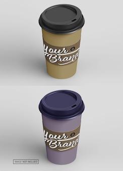 갈색 모자와 컵 홀더 모형으로 테이크 아웃 커피를 닫습니다.