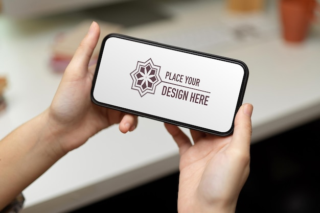 Close up view of female hands holding smartphone mockup