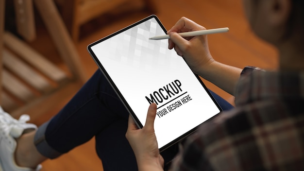 Close up view of female worker using digital tablet mockup with stylus pen